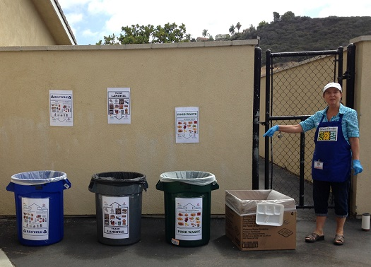 Solana Center volunteer with waste sorting station.